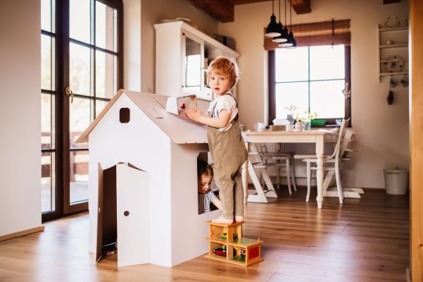 Child plays at home and learns to reuse objects to respect the environment