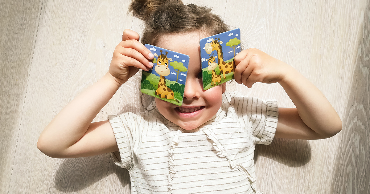 little girl plays with Adventerra Games memory